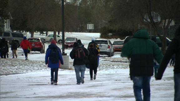 Children walk through the school after classes.