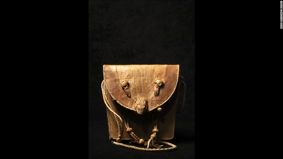 This lizard skin handbag was owned by a hunter who wanted to stand out among his peers.