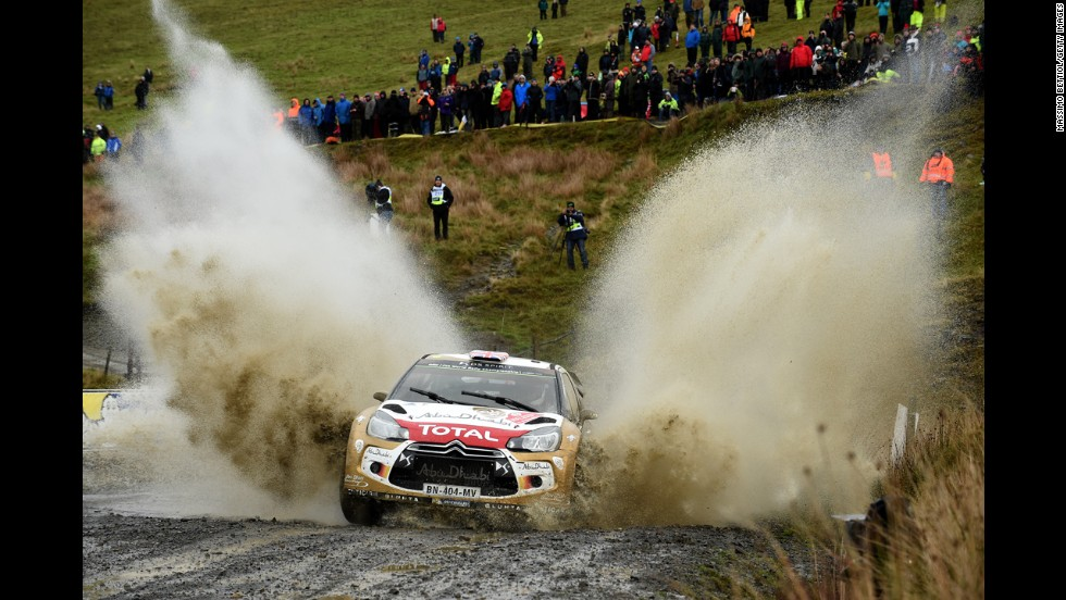 The car of Kris Meeke and Paul Nagle splashes through mud during the World Rally Championship event in Deeside, Wales, on Friday, November 14.