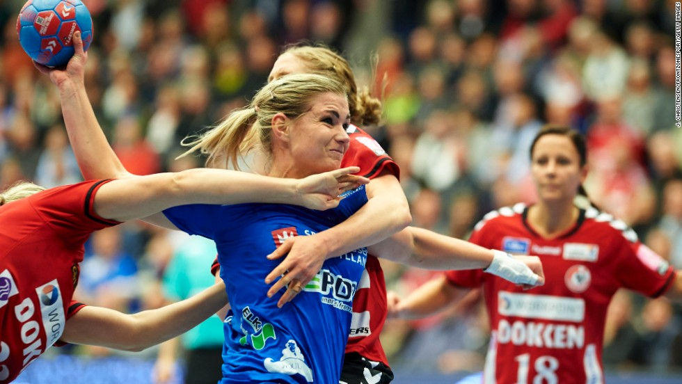 Angelica Wallen, a handball player with Randers HK, is challenged by two players from Team Esbjerg during a Danish league match Wednesday, November 12, in Esbjerg, Denmark.