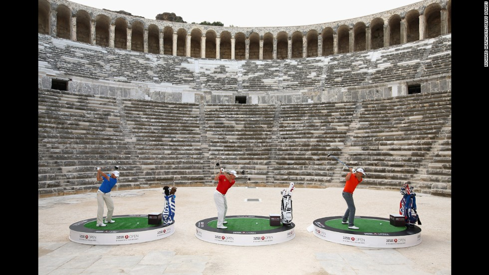 From left, pro golfers Sergio Garcia, Lee Westwood and Henrik Stenson try to hit over the towering walls of the 2,000-year-old Aspendos amphitheater Tuesday, November 11, in Antalya, Turkey. The publicity event was held ahead of the Turkish Airlines Open.