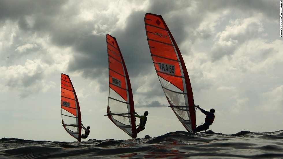 Windsurfers compete Sunday, November 16, during the Asian Beach Games in Phuket, Thailand.