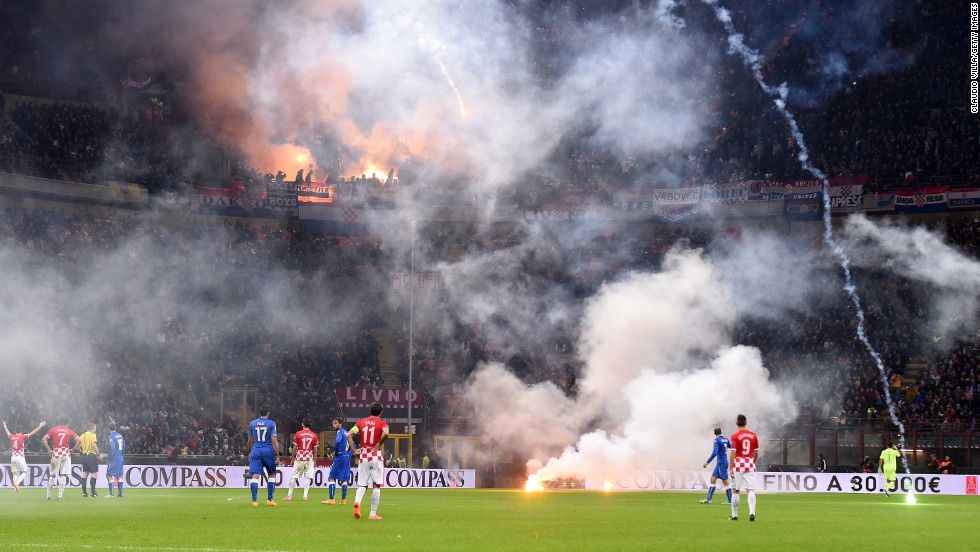 Flares are thrown onto the field by Croatia soccer fans during a Euro 2016 qualifying match Sunday, November 16, in Milan, Italy. The flares delayed the match, which eventually ended in a 1-1 draw.