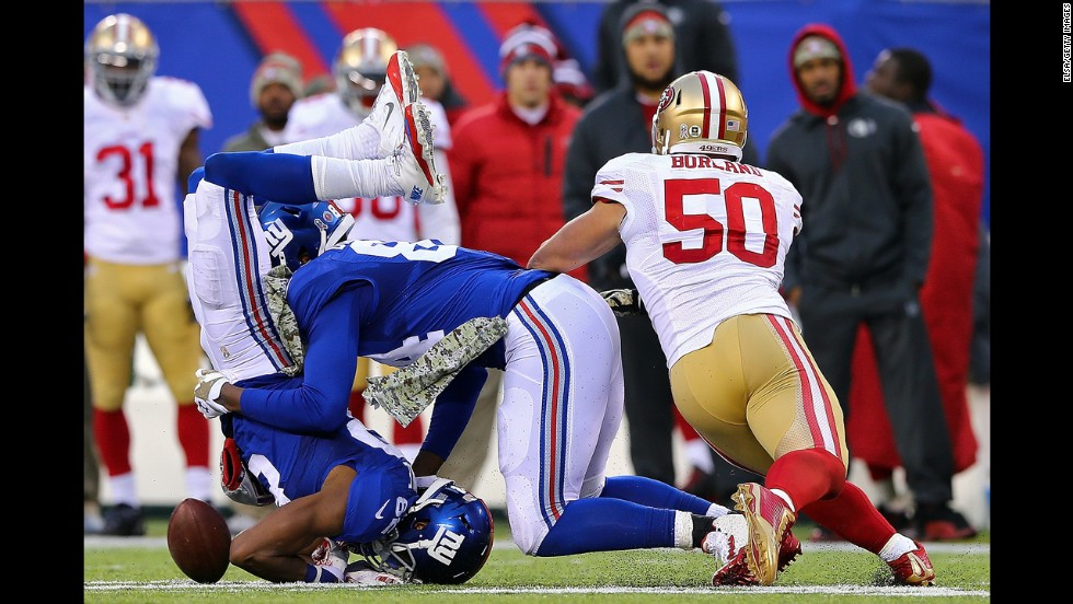Rueben Randle, left, collides with New York Giants teammate Larry Donnell during the team's 16-10 loss to San Francisco on Sunday, November 16.