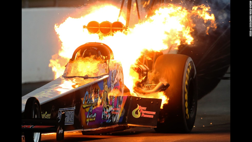 Fire is seen from the dragster of Steve Chrisman during an event in Pomona, California, on Saturday, November 15. It is not uncommon to see fire from drag racing vehicles as their engines are pushed to the limit.