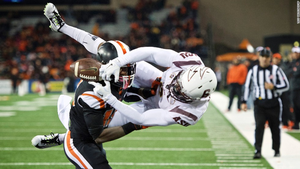 Oregon State cornerback Larry Scott, left, breaks up a pass intended for Arizona State's Cameron Smith during a college football game played Saturday, November 15, in Corvallis, Oregon. Oregon State upset the visiting Sun Devils 35-27.