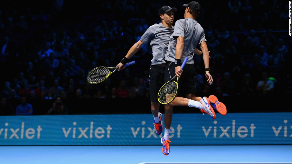 The Bryan brothers, Mike and Bob, celebrate match point during a round-robin doubles match at the ATP World Tour Finals on Wednesday, November 12. The Bryans, the top-ranked doubles team in the world, would go on to win the tournament and add another trophy to their impressive collection.