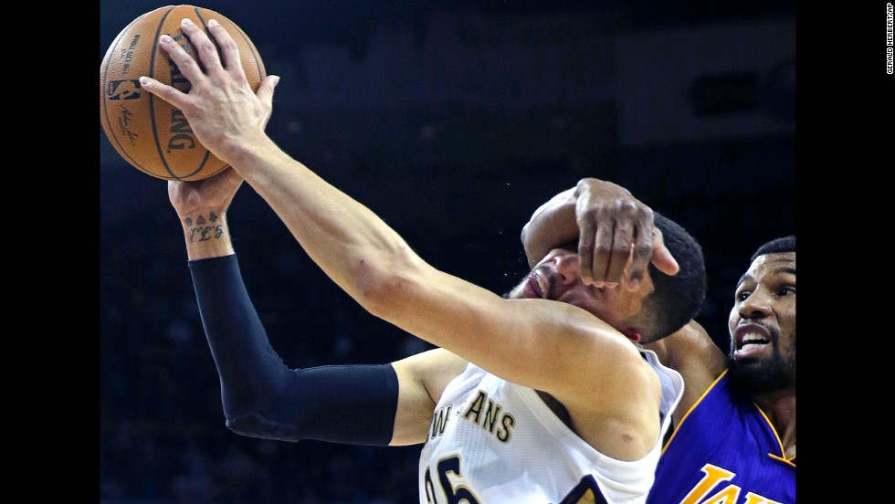New Orleans guard Austin Rivers is fouled by Ronnie Price of the Los Angeles Lakers during the Pelicans' 109-102 victory on Wednesday, November 12. Price was ejected from the game for the flagrant foul.