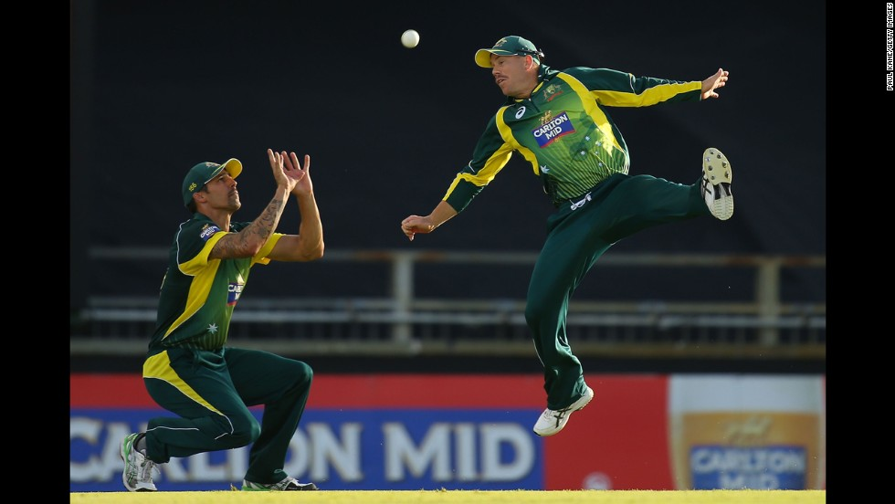 Australian cricket players Mitchell Johnson, left, and David Warner try to make a catch during the One Day International match against South Africa on Sunday, November 16. South Africa won by three wickets.