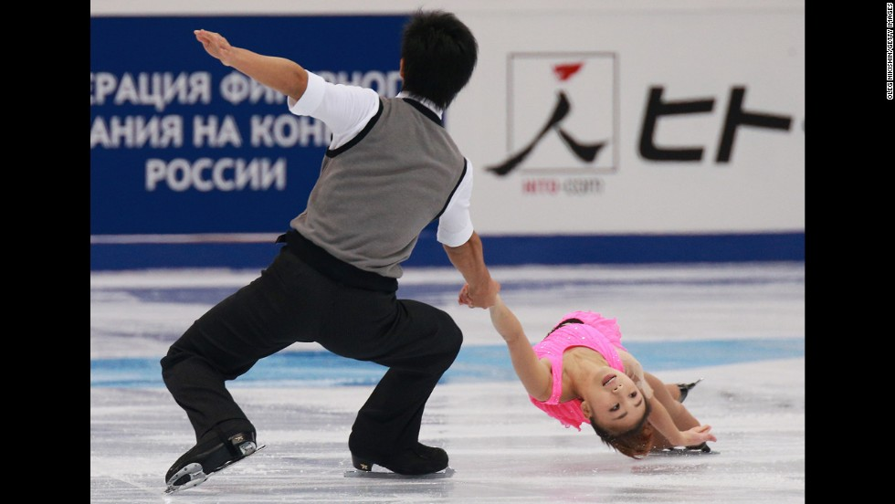 Japan's Ryuichi Kihara, left, and Narumi Takahashi skate together Friday, November 14, during the Rostelecom Cup in Moscow.