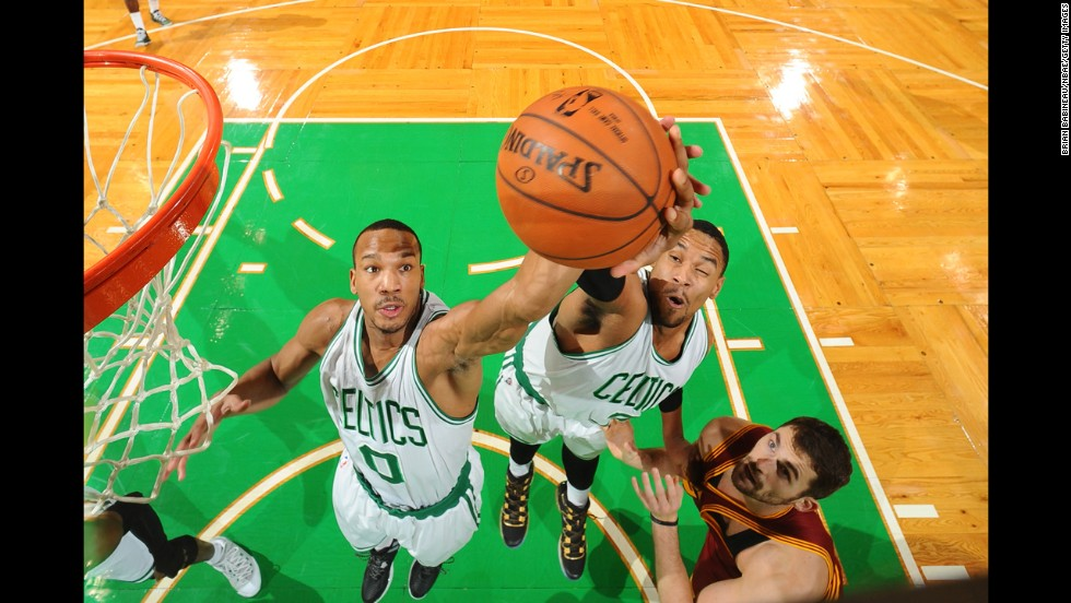 Avery Bradley, left, and Boston Celtics teammate Jared Sullinger jump for a rebound while playing Kevin Love, right, and the Cleveland Cavaliers on Friday, November 14.
