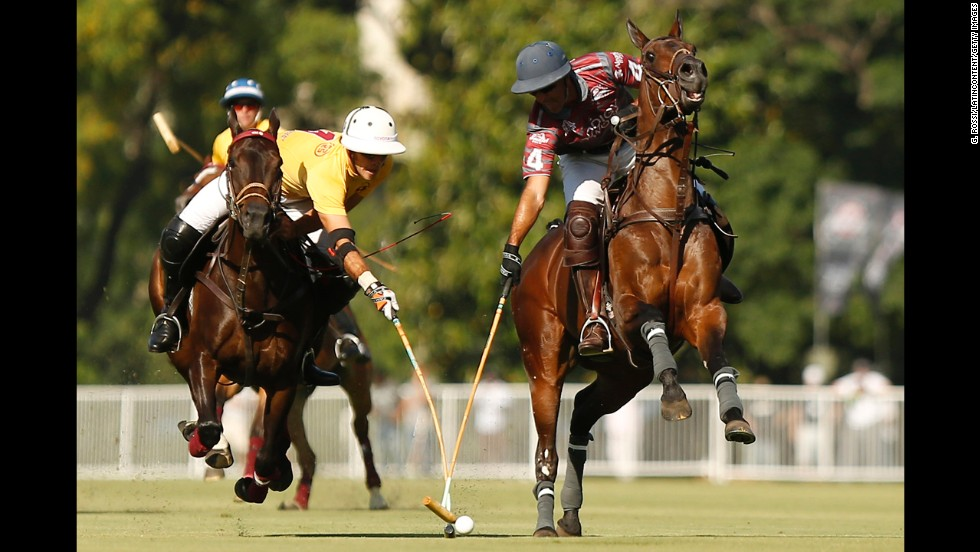 Polo players Facundo Sola, left, and Jaime Garcia Huidobro compete for the ball Saturday, November 15, during a first-round match at the Argentine Polo Open Championship in Buenos Aires.