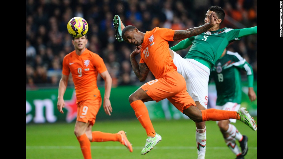 Dutch soccer player Georginio Wijnaldum, center, heads the ball as he challenges Mexico's Diego Reyes during an international friendly played Wednesday, November 12, in Amsterdam, Netherlands. Mexico won 3-2.