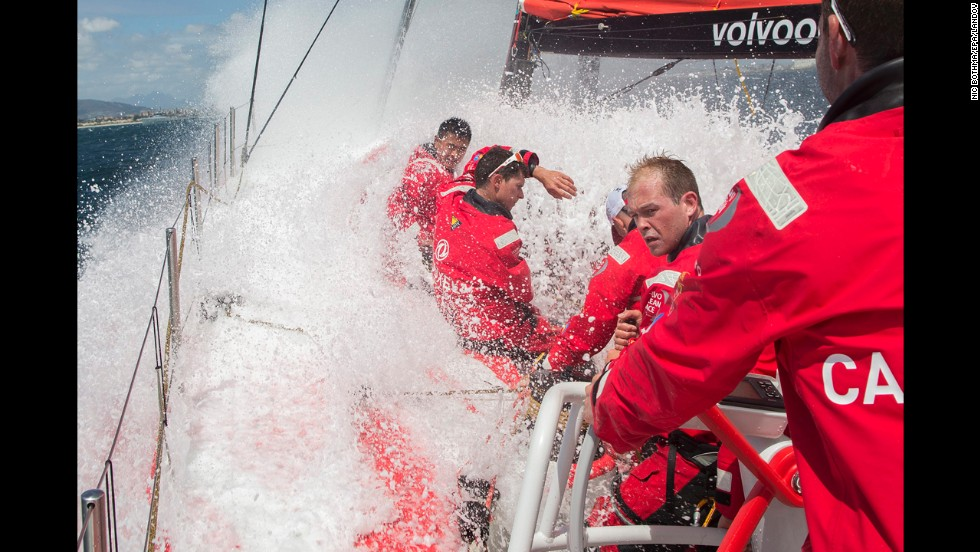Members of the Dongfeng Race Team take a wave over the deck during a practice race for the Volvo Ocean Race on Friday, November 14. The Volvo Ocean Race is the world's premier ocean yacht race. The nine-month competition will visit 11 ports in 11 countries.