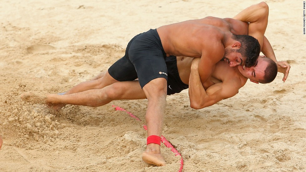 Muhammad Asad of Pakistan and Bek Khaldar Uulu of Kyrgyzstan wrestle Sunday, November 16, during the Asian Beach Games in Phuket, Thailand.