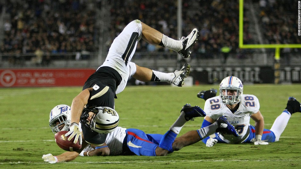 J.J. Worton of the UCF Knights leaps for a touchdown while playing Tulsa in Orlando, Florida, on Friday, November 14. The Knights rolled to a 31-7 victory.