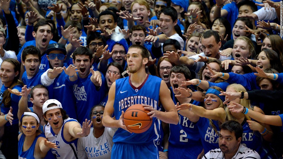 "Duke basketball fans -- aka the ""Cameron Crazies"" -- taunt Presbyterian's Austin Anderson as he inbounds the ball Friday, November 14, in Durham, North Carolina."
