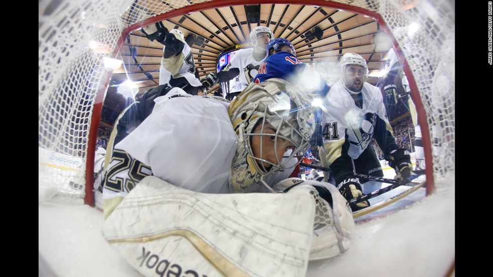 Pittsburgh goalie Marc-Andre Fleury is knocked into the net during an NHL game in New York on Tuesday, November 11.