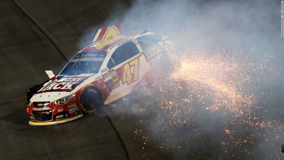 NASCAR driver A.J. Allmendinger wrecks during the season's final Sprint Cup race Sunday, November 16, in Homestead, Florida. Kevin Harvick won the race to clinch his first Sprint Cup championship.