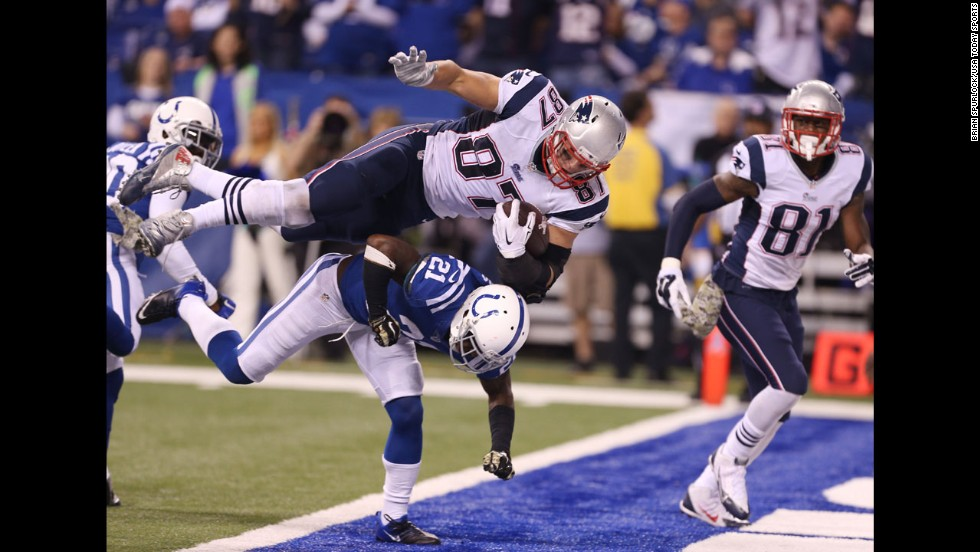 New England Patriots tight end Rob Gronkowski scores a touchdown over Indianapolis Colts cornerback Vontae Davis during the Patriots' 42-20 win on Sunday, November 15.