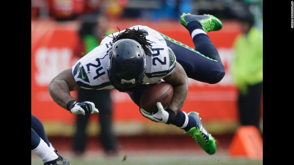 Seattle Seahawks running back Marshawn Lynch stumbles in the first half of an NFL game at Kansas City on Sunday, November 16.