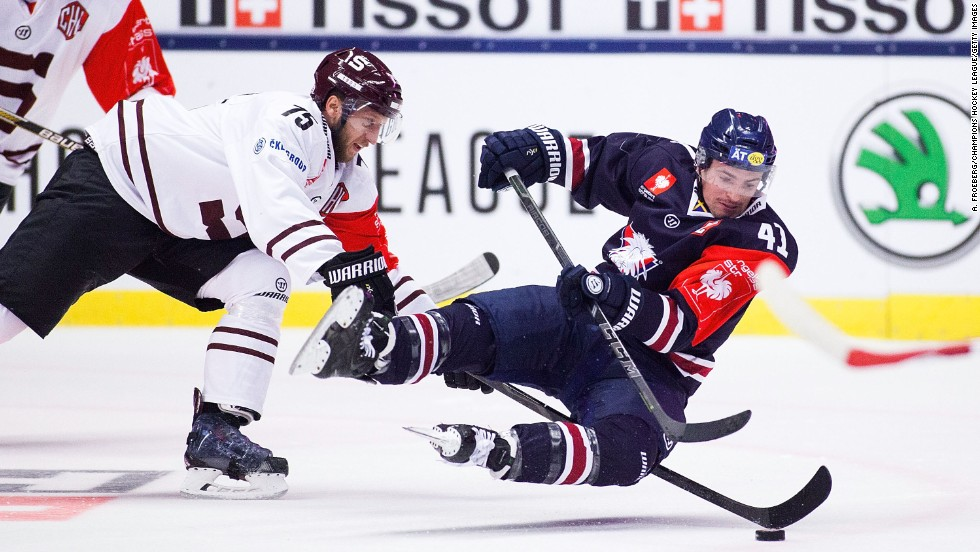 Jan Piskacek of Sparta Prague, left, and Broc Little of Linkoping battle for the puck during a Champions Hockey League game in Linkoping, Sweden, on Tuesday, November 11. The game ended 2-2 and Linkoping advanced to the tournament quarterfinals.