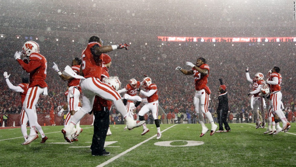 "Wisconsin football players dance to the House of Pain song ""Jump Around"" -- a tradition for home games -- before the fourth quarter of the Badgers' 59-24 win against Nebraska on Saturday, November 15. <a href=""http://www.cnn.com/2014/11/11/worldsport/gallery/what-a-shot-1111/index.html"">See 39 amazing sports photos from last week</a>"
