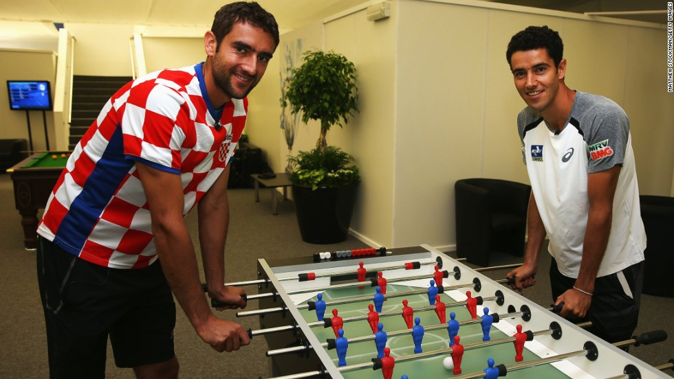 A keen AC Milan fan, Cilic wears his Croatia top with pride as he plays table football with fellow tennis pro Andre Sa of Brazil on the day the two teams opened the 2014 World Cup. The South Americans would win 3-1 hours later in Sao Paulo.