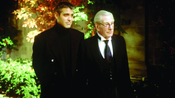 """George Clooney (seen here with Michael Gough in """"Batman & Robin"""") was both the caped crusader and the sexiest man alive in 1997."""