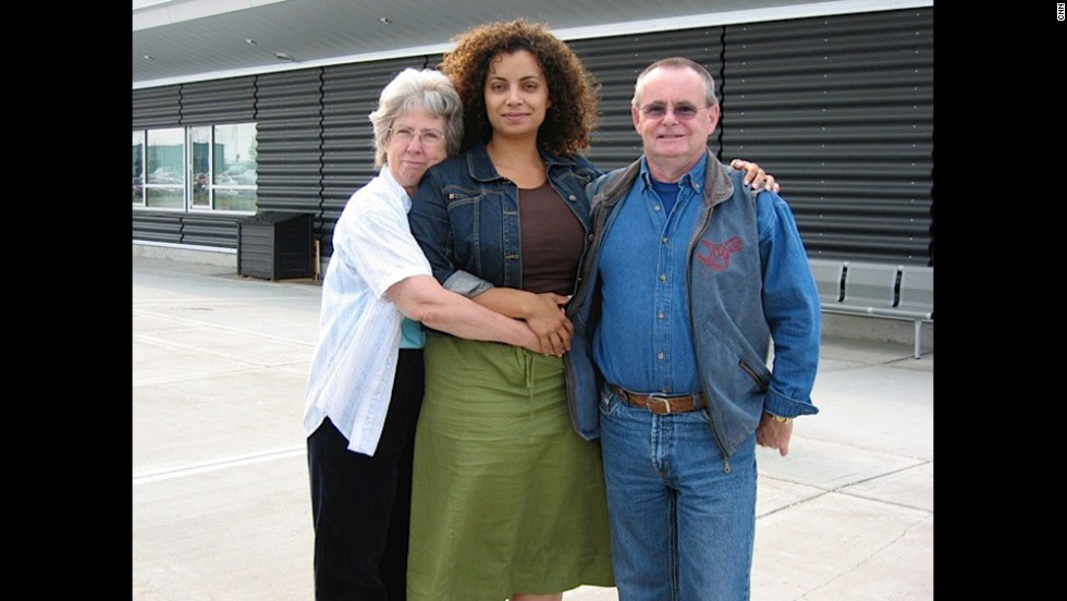 Mom, Dad and me pictured outside an airport; I was leaving to go back to whatever city I was living in at the time. You can see the sadness on my face. It's tough being so far away from them.