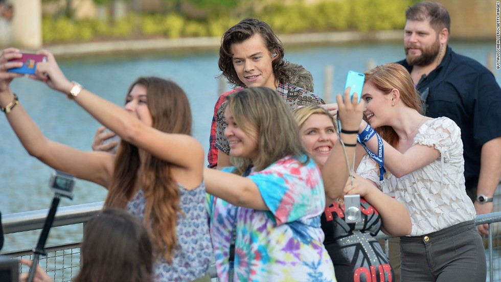 "Fans in Orlando, Florida, take photos in front of One Direction star Harry Styles on Monday, November 17. Styles was appearing on NBC's ""Today"" show to promote the band's new album, ""Four."""