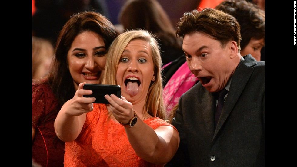 "Extreme close-up! Actor Mike Myers harkens back to <a href=""https://www.youtube.com/watch?v=kdz3rHmQbsw"" target=""_blank"">his ""Wayne's World"" days</a> as he takes a selfie with guests at the Hollywood Film Awards on Friday, November 14."