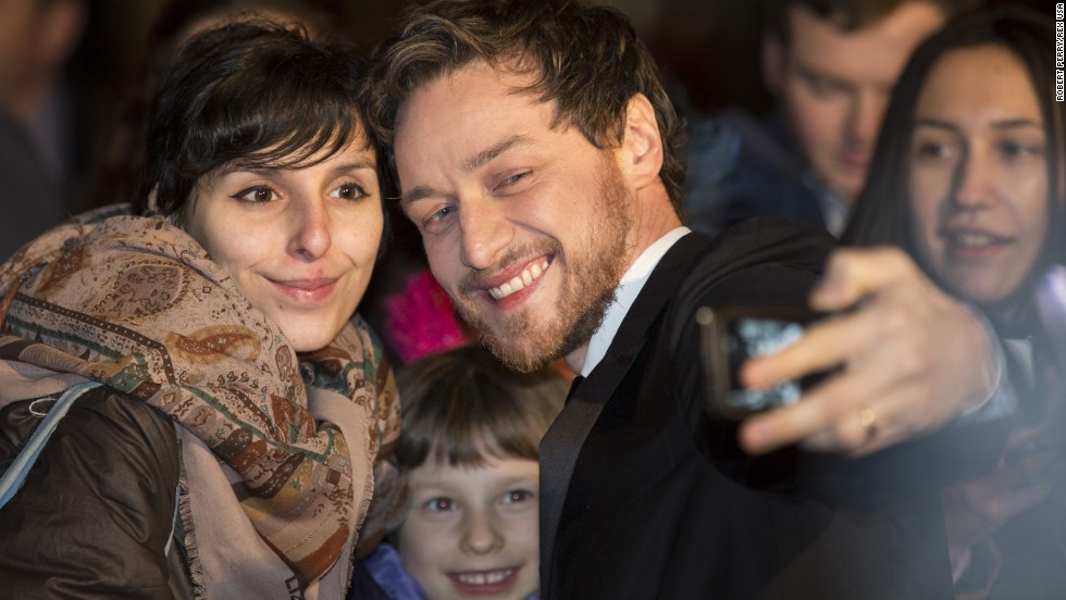 Actor James McAvoy snaps a selfie with fans in Glasgow, Scotland, ahead of the Scottish BAFTA awards on Sunday, November 16.