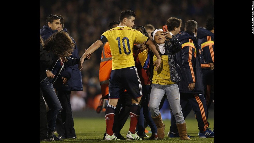 A soccer fan grabs Colombia's James Rodriguez after Colombia defeated the United States 2-1 in London on Friday, November 14.