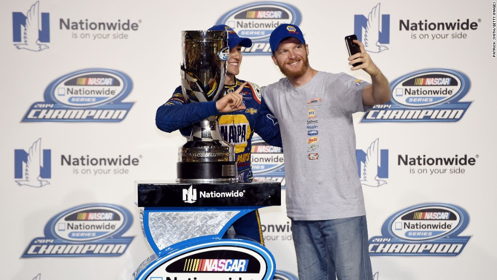 "Racer Chase Elliott (left, with trophy) attended a Trump rally in Georgia.  ""It is my great honor to endorse Mr. Trump for President of the United States. He is a leader representing strength and common sense solutions,"" Elliott said, according to Trump's campaign website."