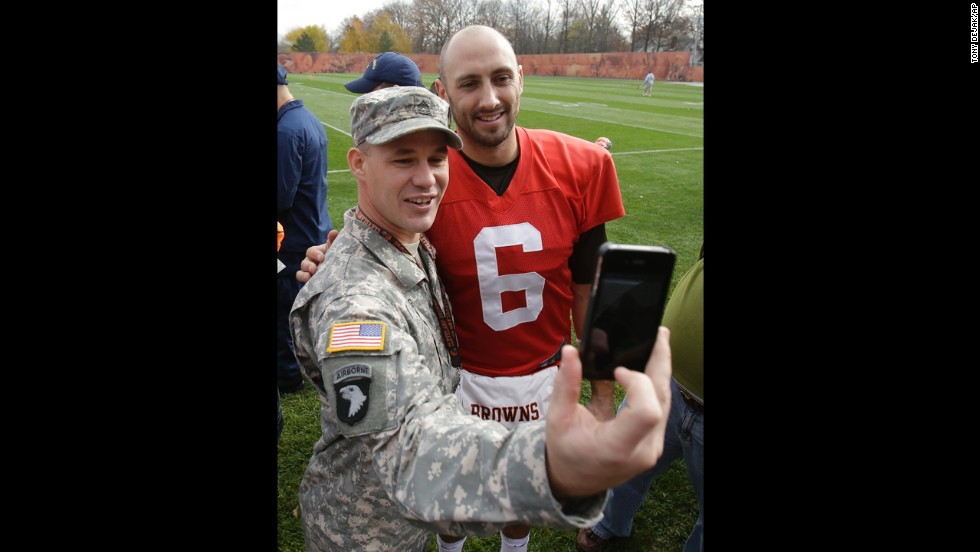 U.S. Army soldier Jeremy King gets a photo with Cleveland Browns quarterback Brian Hoyer at a Browns practice on Tuesday, November 11. As part of the Salute to Service campaign, guests representing all five branches of the U.S. military were able to watch the Browns practice on Veterans Day.