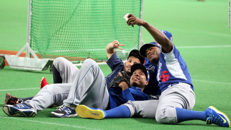 From left, Major League Baseball players Jose Altuve, Salvador Perez and Yasiel Puig take a selfie Tuesday, November 18, at the Sapporo Dome in Hokkaido, Japan. They were part of the MLB All-Stars team that played five exhibition games against Japan's national baseball team. Japan won three of the five games.