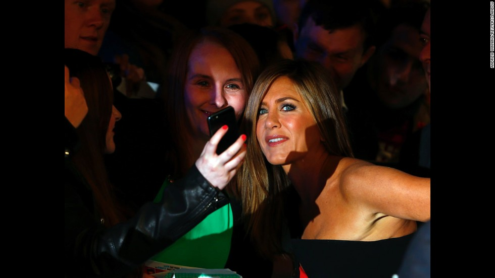 "Actress Jennifer Aniston, right, stops for a selfie with a fan in London at the world premiere of ""Horrible Bosses 2"" on Wednesday, November 12."