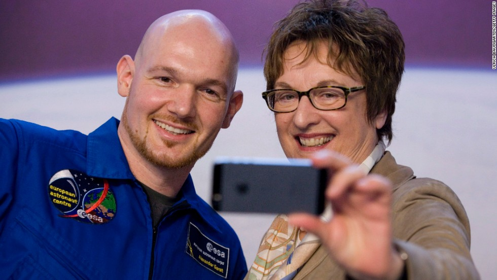 Alexander Gerst, an astronaut from the European Space Agency, poses for a selfie with German politician Brigitte Zypries on Thursday, November 13, in Cologne, Germany. Gerst recently returned to Earth following a mission on the International Space Station.