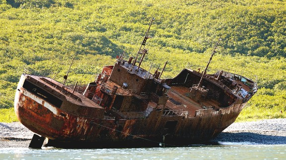 An abandoned ship rests on the shores of the Kamchatka Peninsula in the Russian Far East. The 900 mile-long peninsula is roughly the size of California and is home to a large collection of volcanoes.