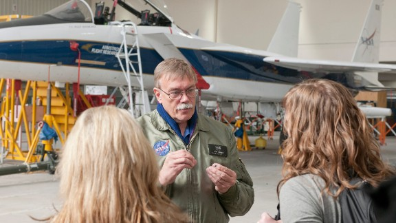 Tom Grindle, supervisor of aircraft missions operations, talks to attendees about an F-15 flight research support aircraft.