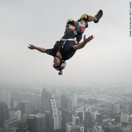 A BASE jumper leaps from the 300-meter (approximately 984-foot) Open Deck of Malaysia's landmark Kuala Lumpur Tower. BASE is an acronym for building, antenna, span, earth -- referring to the types of fixed objects participants leap from before using parachutes to slow their falls.