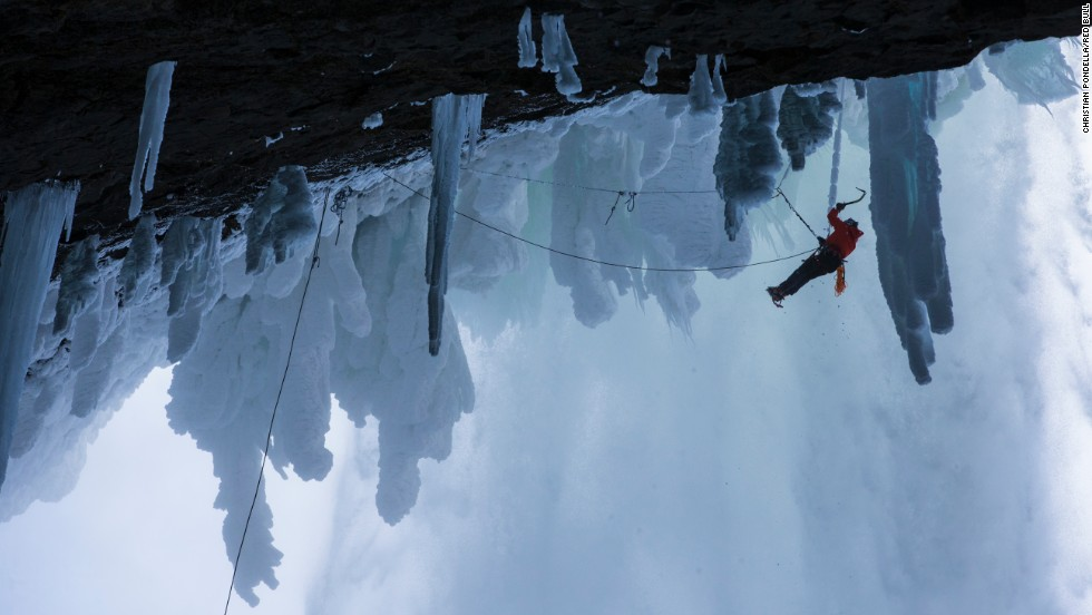 Ice climber Will Gadd ascends Helmcken Falls at Wells Gray Provincial Park in British Columbia, Canada. The 450-foot cascade never fully freezes, but it leaves a blanket of ice on the surrounding walls. It's considered one of the world's most difficult climbs.