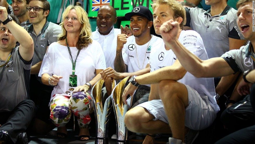 Round 14: Rosberg joins Hamilton and his family for the celebrations in Singapore but another win for the Briton means Rosberg loses his championship lead.