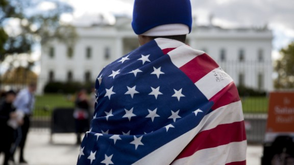 Jose Cruz wears a U.S. flag during a demonstration in favor of immigration reform outside of the White House in Washington on Nov. 7, 2014.