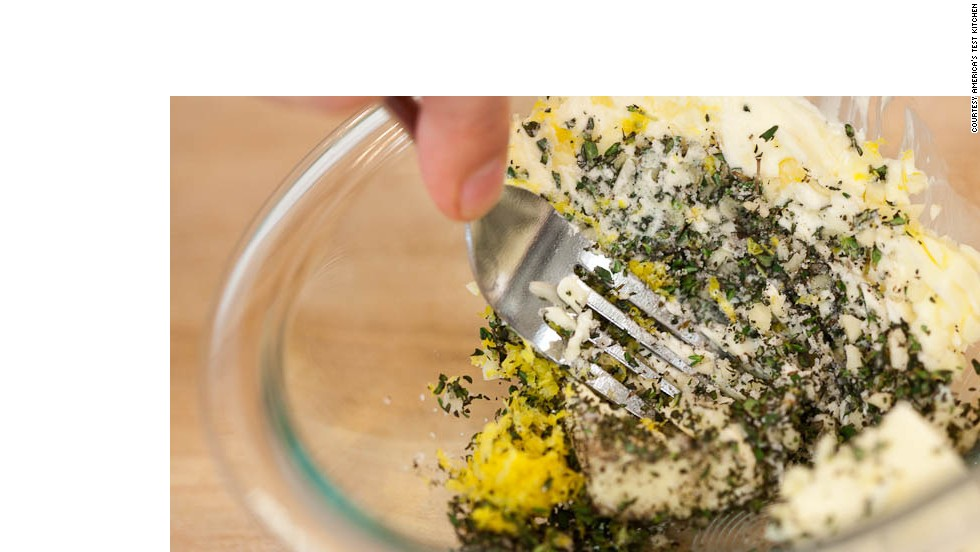 Mix butter, garlic, thyme, lemon zest, ¾ teaspoon salt and ¼ teaspoon pepper in medium bowl with rubber spatula or fork until thoroughly combined. Adjust oven rack to middle position and heat oven to 425 degrees.