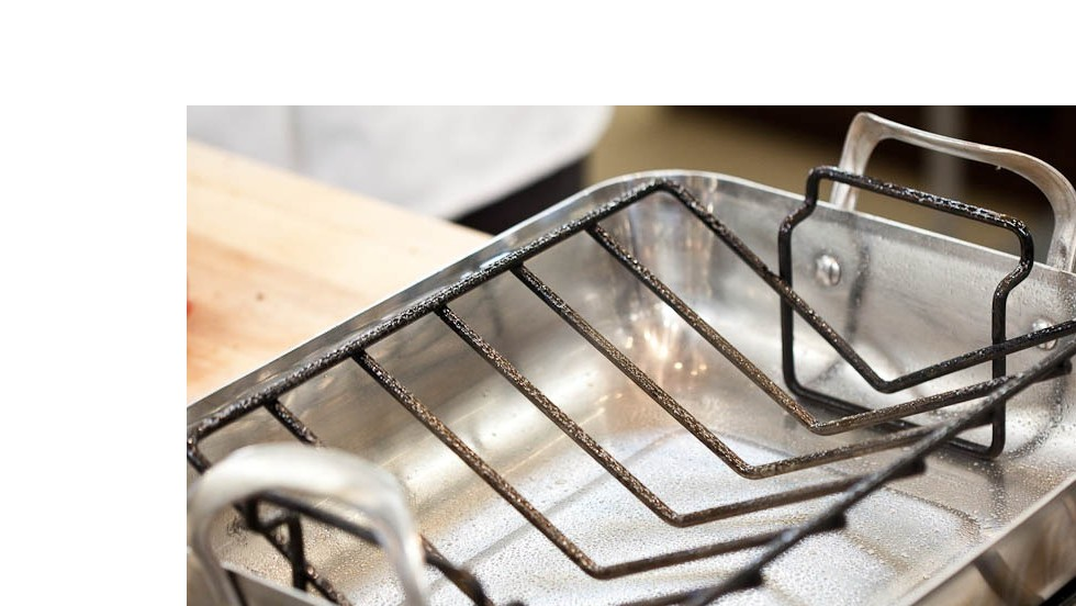 Set V-rack inside large roasting pan and spray with vegetable oil.