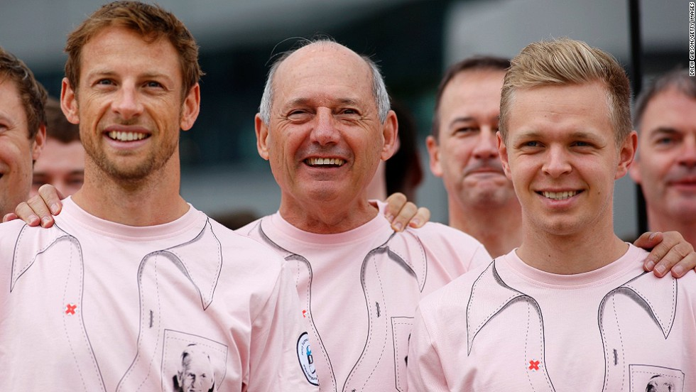 With Alonso linked to a McLaren return, the future of the team's current drivers Jenson Button (left) and Kevin Magnussen (right) lies in the hands of McLaren chairman Ron Dennis (center.)