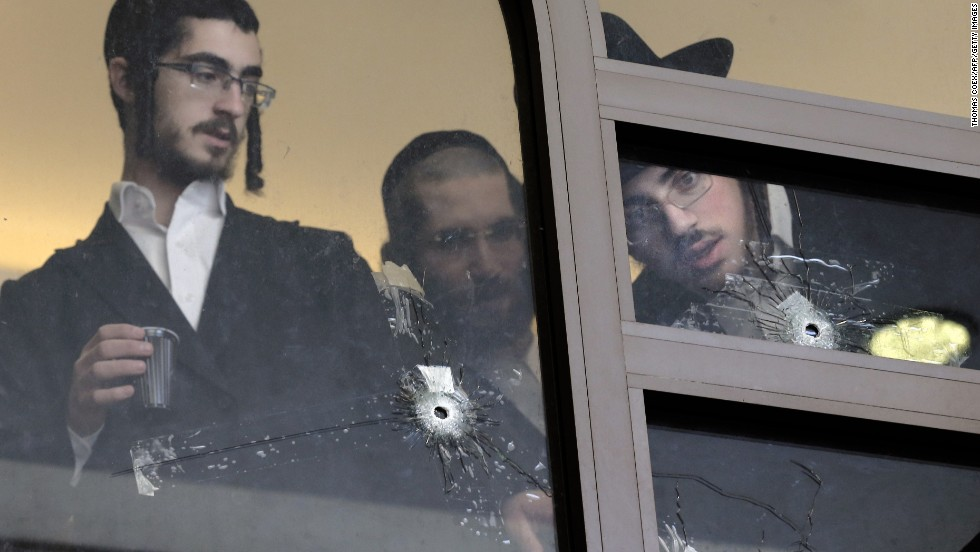 "Men look at bullet holes on the main window of a Jerusalem synagogue that was attacked Tuesday, November 18, by two Palestinian men. Four worshippers and a police officer were killed and several others were wounded in the <a href=""http://www.cnn.com/2014/11/18/middleeast/gallery/jerusalem-synagogue-attack/index.html"">deadliest terror attack in Jerusalem</a> since 2008."