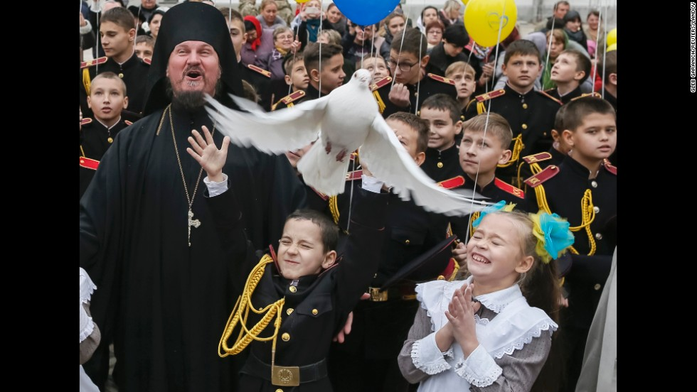 A young military cadet releases a pigeon after an oath-taking ceremony Friday, November 14, at a monastery in Kiev, Ukraine.